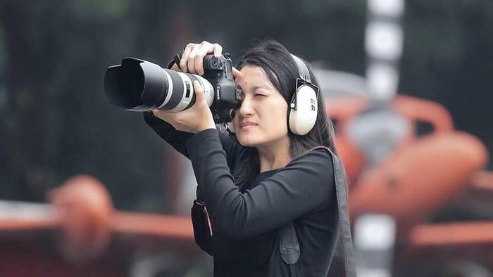 13.   Fotografer